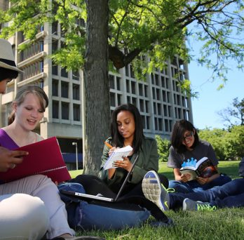 Students studying in front of University Hall.